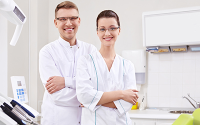 two dental assistants standing and smiling
