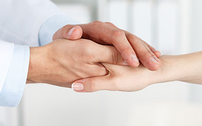 Doctor's hand shaking a patient hand