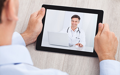 A patient talking to the doctor on an Ipad