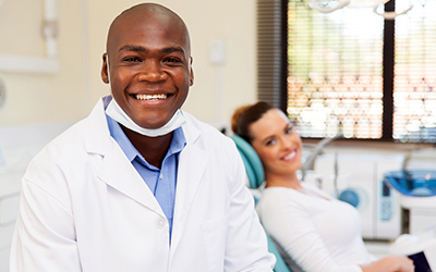 Dentist and patient in background